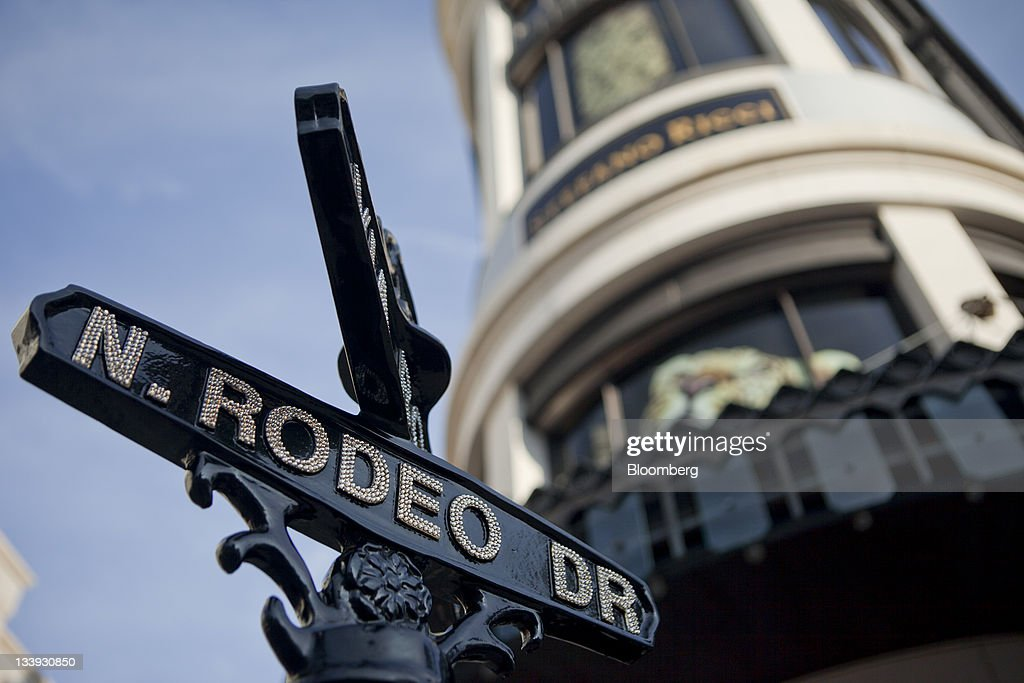 Street signs stand on Rodeo Drive in Beverly Hills, California, U.S., on Thursday, Nov. 17, 2011. U.S. retail sales growth will slow to 2.8 percent during the holiday season this year, restrained by decelerating job growth, a weak housing market and a volatile stock market, the National Retail Federation said. Photographer: Andrew Harrer/Bloomberg via Getty Images