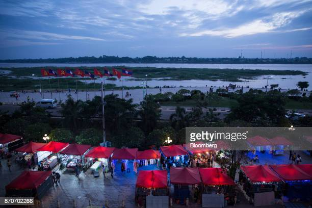 Street stalls stand illuminated at a night market along the Mekong river in Vientiane Laos on Thursday Nov 2 2017 Located in the Mekong region...