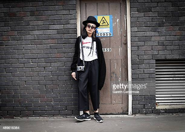 A street style photographer is photographed during London Fashion Week Spring/Summer 2016/17 on September 19 2015 in London England