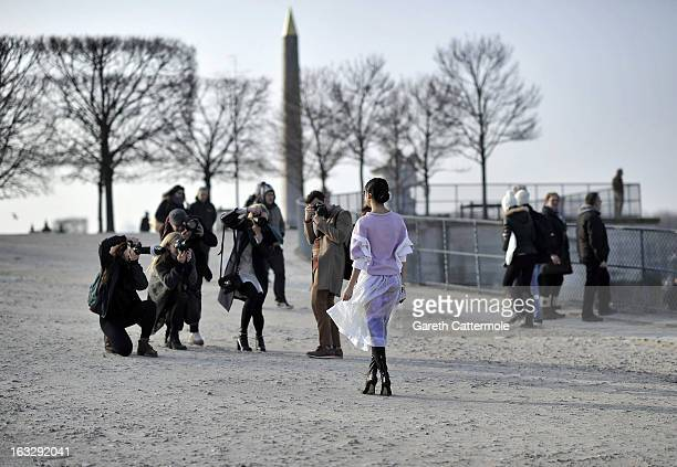 Street style photographers capture a woman during Paris Fashion Week on March 3 2013 in Paris France