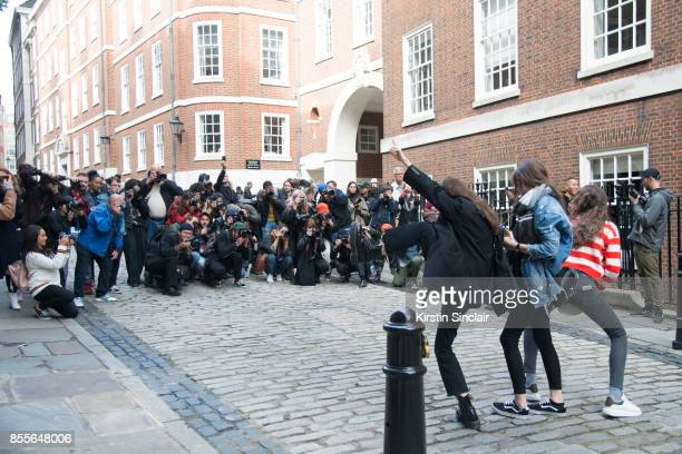 Street Style photographers photographing models on day 2 of London Womens Fashion Week Spring/Summer 2018 on September 16 2017 in London England