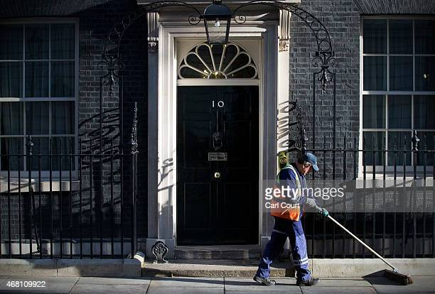 A street sweeper cleans the pavement in front of 10 Downing Street on March 30 2015 in London England Campaigning in what is predicted to be...