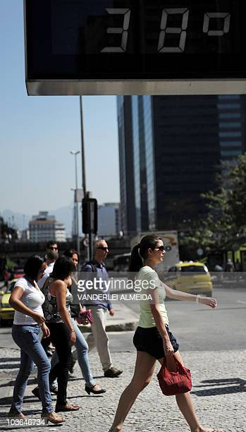 A street thermometer in Rio de Janiero marks 38 degrees Celsius as the Brazilian city is still in winter on August 26 2010 An unusual heat wave for...