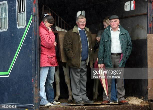 Street traders ake shelter at the Auld Lamas fair in Ballycastle Co Antrim