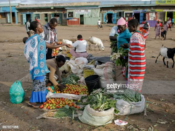 Street traders sell their goods at a market on May 17 2017 in Talek Kenya