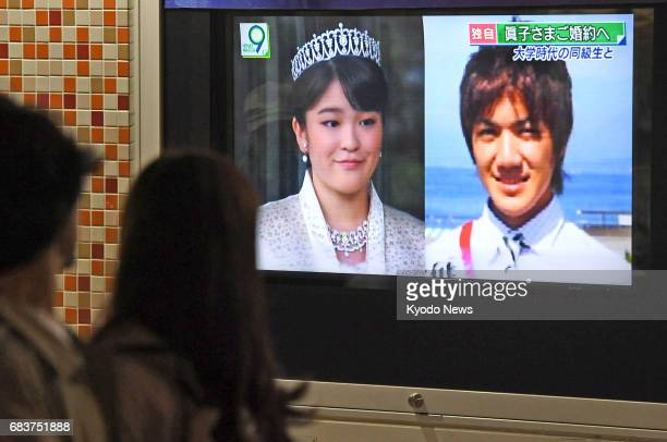 A street TV in Tokyo's Yurakucho area shows a news report saying that Princess Mako the first grandchild of Japanese Emperor Akihito will soon become...