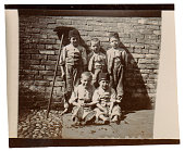 Vintage photo from the late Victorian early Edwardian period showing a group of poor children on the street.  England.