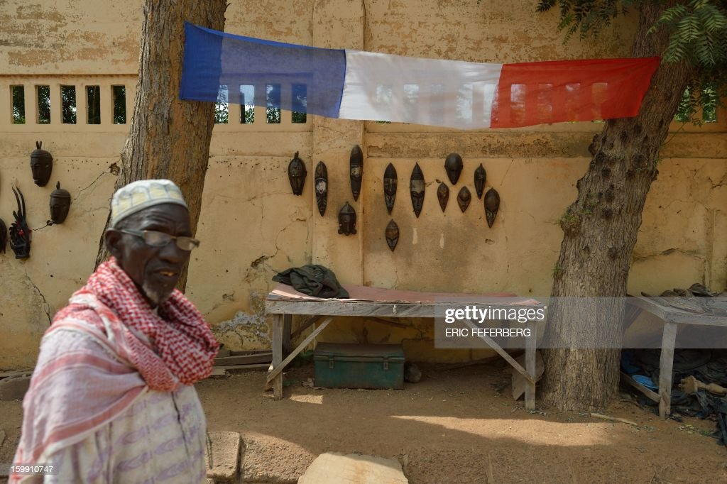A street vendor display a French flag over his stall on January 22, 2013 in Segou, 240 kms north of Bamako, as life starts returning to normal following the French-led offensive in Mali. Mali's army chief said on January 22 that his French-backed forces could reclaim the northern towns of Gao and fabled Timbuktu from Islamists in a month, as more offers of aid poured in for the offensive. French planes bombed a major base of the Al-Qaeda in Islamic Maghreb (AQIM) near Timbuktu as local sources said a mansion belonging to Libyan former strongman Moamer Kadhafi was destroyed.