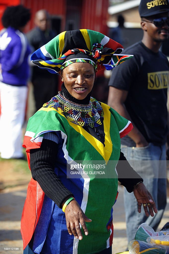 A street vendor dressed with South African flags displays her merchandise in Vilakazi street as residents from Soweto cheer on May 21, 2010 during the official celebration marking 20 days ahead of the FIFA WC2010 kick off, in Johannesburg, South Africa. South Africa will host the FIFA World Cup football tournament from the 11 of June to the 11 of July, 2010.