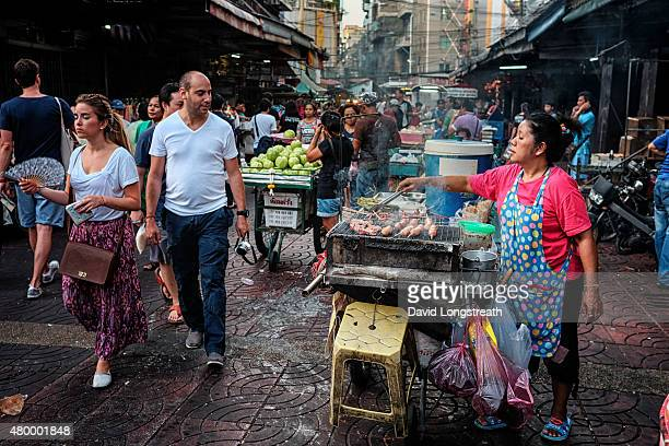 CHINATOWN BANGKOK THAILAND A street vendor prepares food in Chinatown Chinatown is located in one of the oldest areas of Bangkok It represents the...
