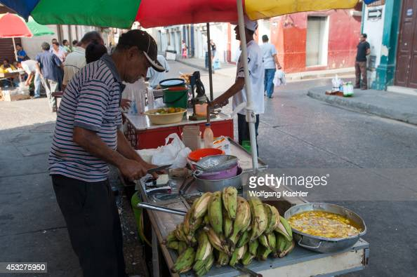 Street vendor preparing fried plantains in the streets of Cartagena Colombia