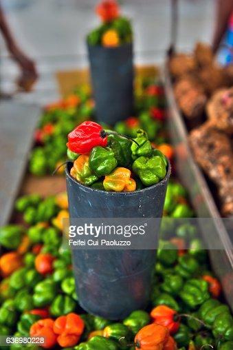 Street vendor selling Caribbean peppers at Cienfuegos town in Cuba