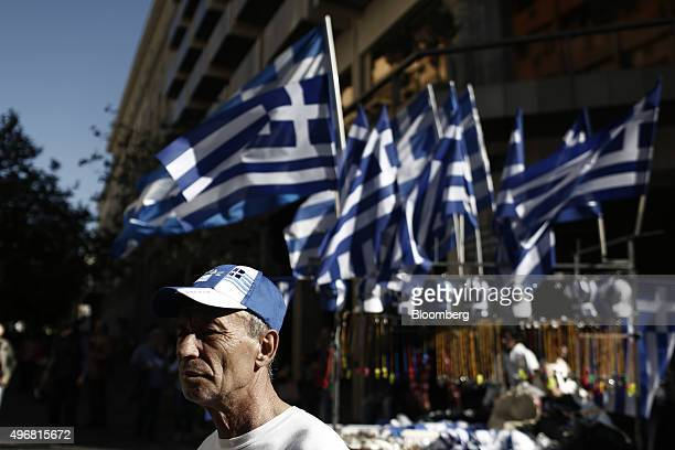 A street vendor selling Greek national flags stands by his stall during a 24 hour general strike in Athens Greece on Thursday Nov 12 2015 As many as...