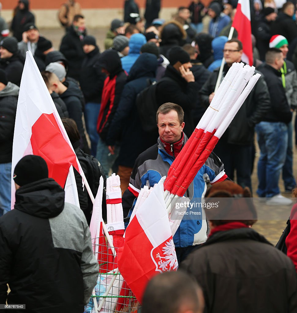 A street vendor selling Polish flags attends a demonstration against immigration and refugees coming to Europe in the old city sqaure in Warsaw. Hundreds of people gathered in Warsaw, Poland in the old city square protesting against what the organizers of the demonstration called the, Islamization of Europe. The National Movement (Ruch Narodowy) group and the Youth Movement (Modzie Wszechpolsk) group, both Polish right wing groups organized the march as a way to show, in the groups opinion that Poles and the rest of Europe are against allowing any immigrants and refugees from the Middle East to come to Europe. Group organizers warned people that police had told them no racist epitaphs would be tolerated, however, large groups of Polish men yelled racist slurs and epitaphs during the rally. The protest was part of a European-wide protest happening in other major cities across Europe including Dresden, Germany, Prague, Czech Republic, and Bratislava, Hungary.