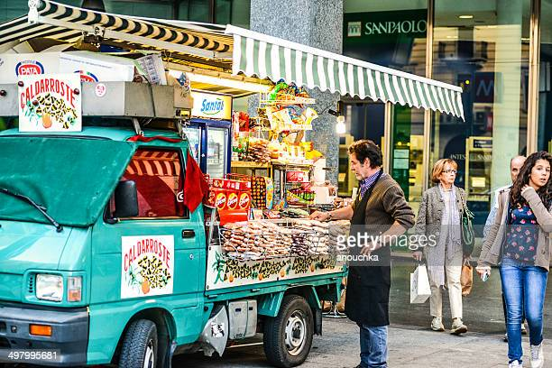 Street vendor selling snacks and candies from his truck, Milan