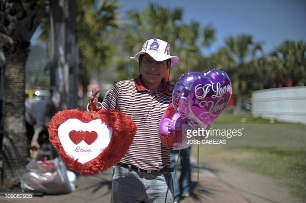 A street vendor sells balloons in a street of San Salvador on Saint Valentine's Day on February 14 2011 Love swept around the world Monday as the...