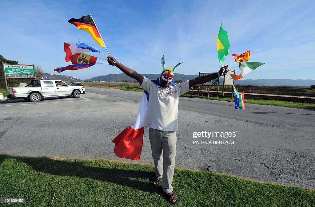 A street vendor sells flags of the different countries qualified for the 2010 World Cup on a street in Knysna, in southern South Africa on June 5, 2010. Knysna will host the teams of France and Denmark during the World Cup, which will start on June 11.