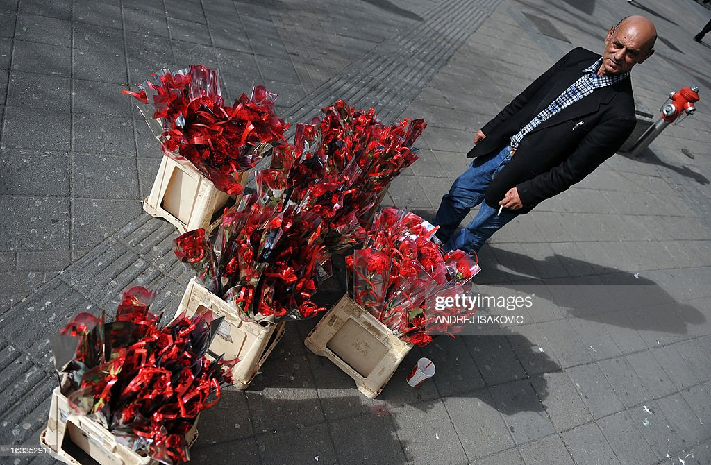 A street vendor sells flowers on March 8, 2013 in central Belgrade on International Women's Day.