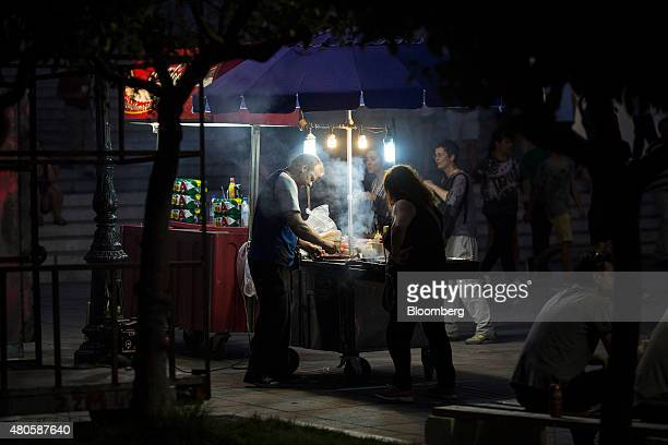 A street vendor sells hot cooked food from his mobile stall on Syntagma Square in Athens Greece on Sunday July 12 2015 Greece has been in financial...
