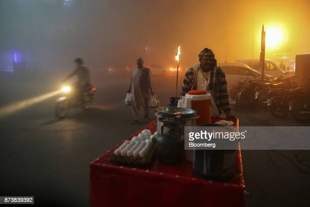 A street vendor sells soup along a road shrouded in smog at night in Lahore Pakistan on Monday Nov 13 2017 The fates of 15 billion people in both...