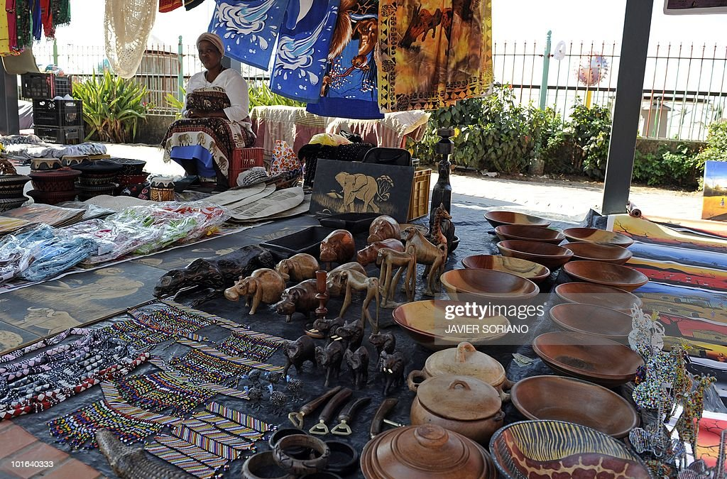 A street vendor waits for customers in a street market along Durban's beach in South Africa, on June 5, 2010.