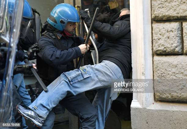 Street vendors and taxi drivers clash with police during a demonstration in front of the Democratic Party headquarters to protest against the EU...