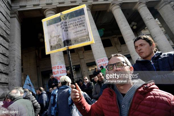 Street Vendors and taxi drivers protest against the Bolkestein Directive in front of Palazzo Chigi on February 21 2017 in Rome Italy