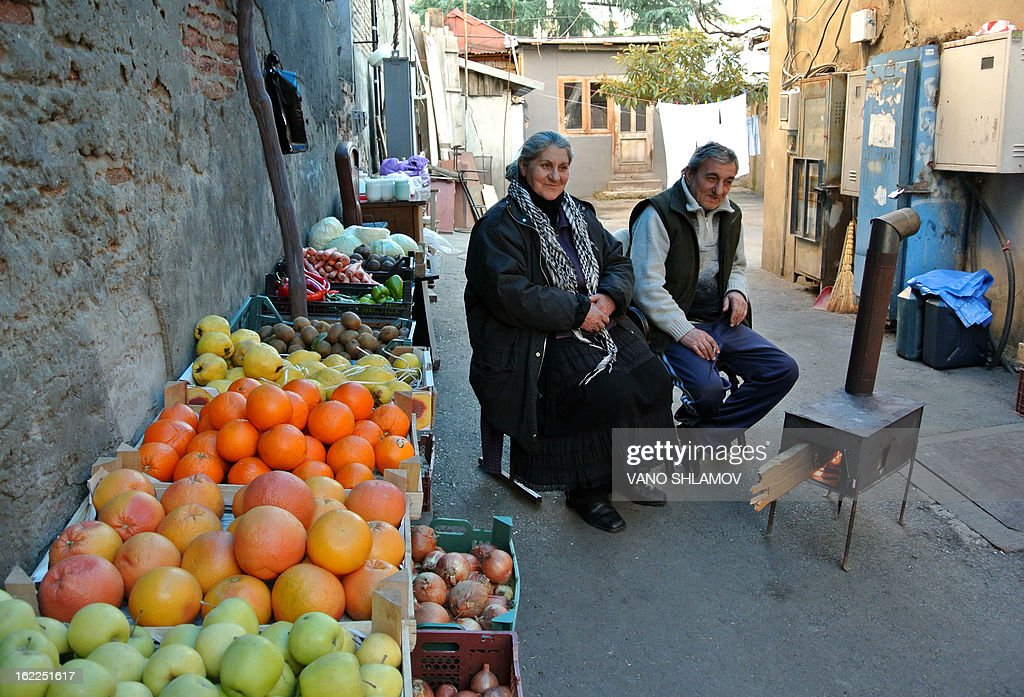 Street vendors sell fruits in Tbilisi, on February 21, 2013. AFP PHOTO /VANO SHLAMOV