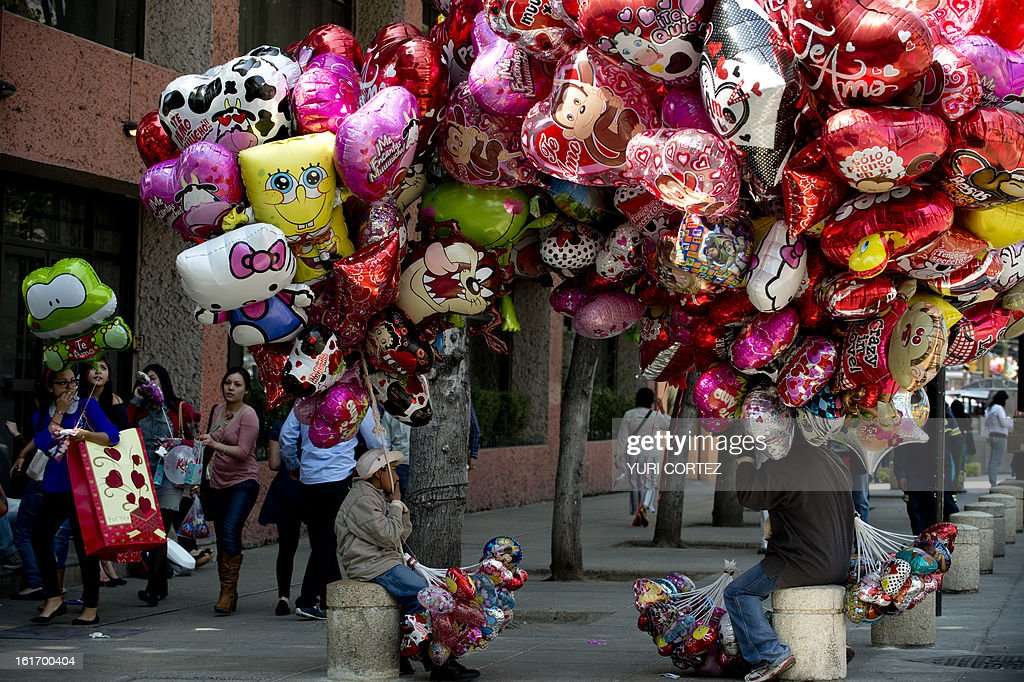 Street vendors sell Valentine's Day gifts during Mexico's 'One Billion Rising' flashmob against violence against women, at the Republic Square in front of the Monument to the Mexican Revolution, in Mexico City on February 14, 2013. The 'One Billion Rising' is a protest held in about two hundred countries around the world on St Valentine's day. AFP PHOTO/Yuri CORTEZ