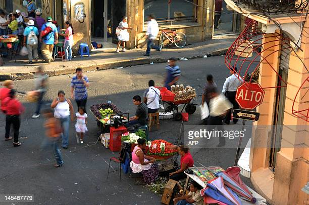 Street vendors wait for clients in Plaza Libertad downtown San Salvador El Salvador on May 30 2012 According to an opinion poll of the Central...