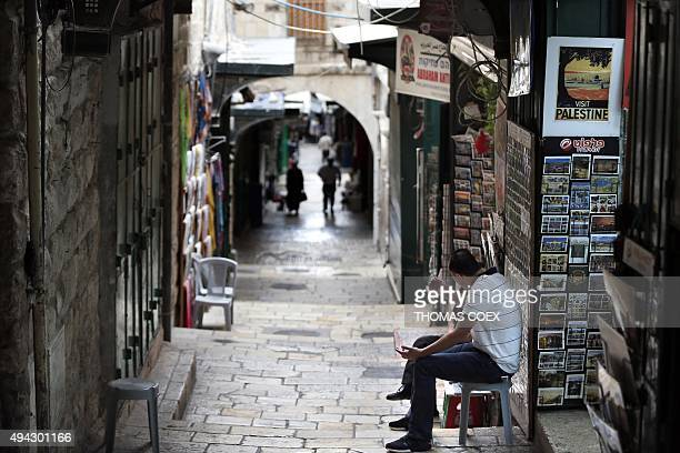 Street vendors wait for clients in the Via Dolorosa street in the Christian quarter in the Jerusalem's Old City near the Church of the Holy Sepulchre...