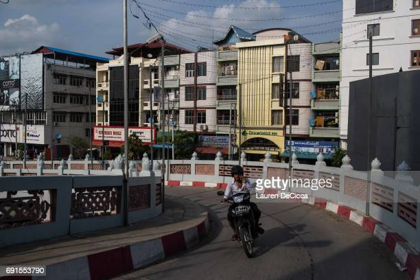 A street view in downtown on June 1 2017 in Mandalay Burma Buddhist hardliners like Ashin Wirathu are pushing the idea that Buddhism and the essence...