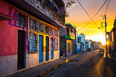 The warm sunset light shines on the empty streets of the world heritage city centre in the Cuban city of Camaguey, a unique Latin American city in the Caribbean - Camaguey, CUBA in January 2016
