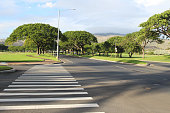 A view of an empty street intersection with the crosswalk, Kapolei, Oahu, Hawaii, USA