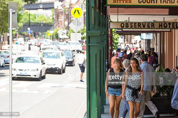 Street with cars, tourist and sightseers shopping and ejoying day