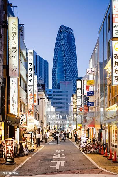 Street with neon signs in Shinjuku, Tokyo, Japan