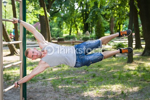 Street workout man exercise in a park