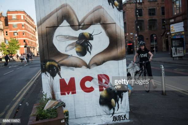 A streetart mural created following the May 22 terror attack at the Manchester Arena featuring bees which are synonymous with Manchester as a symbol...