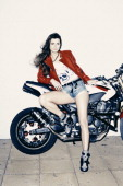 Streetbike freestyle stunt rider singer and model Chesca Miles is photographed for Red Bulletin on August 29 2013 in London England