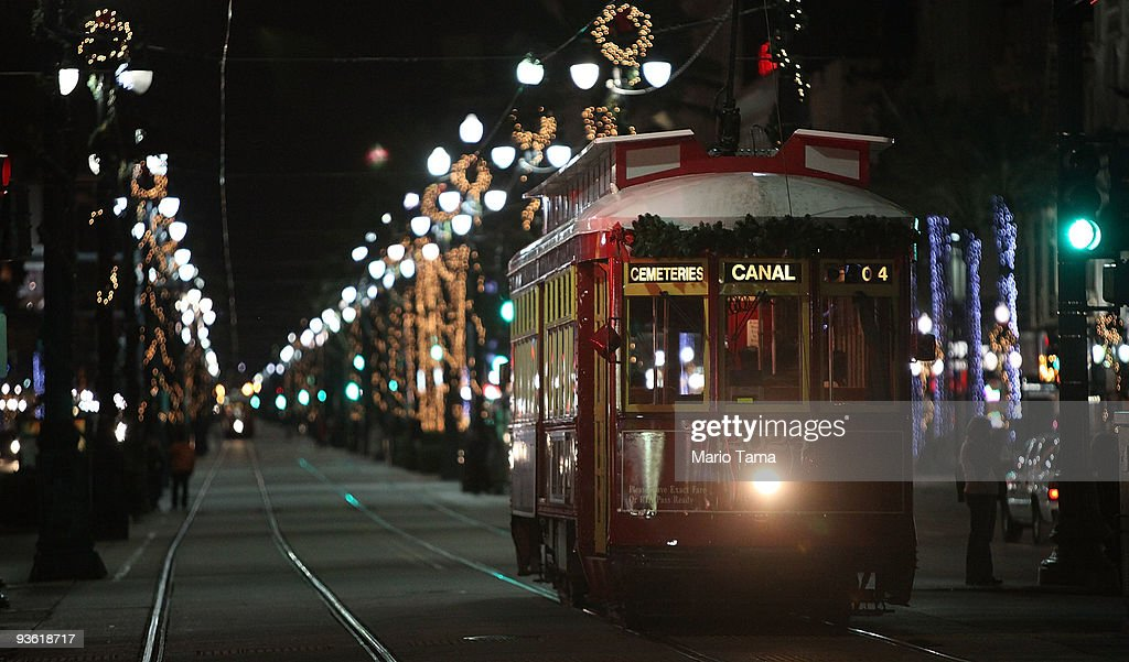 A streetcar passes along Canal Street decorated with Christmas lights December 2 2009 in New Orleans Louisiana People across the country are getting...