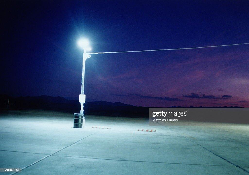 Streetlight on petrol station driveway, night : Stock Photo
