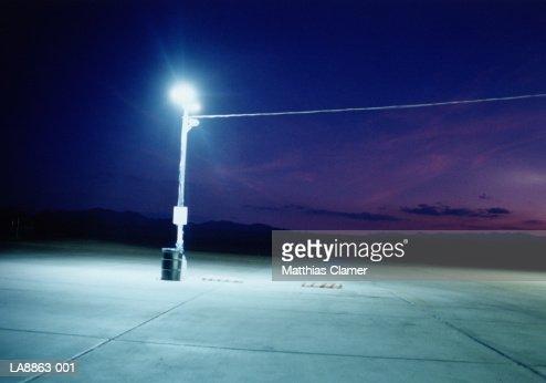 Streetlight on petrol station driveway, night : Foto stock