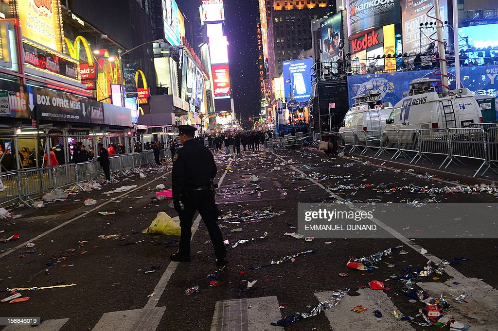 Streets are deserted following New Year celebrations on Times Square January 1, 2013 in New York. A million people cheered in New York's Times Square as the traditional crystal ball dropped to mark the start of 2013, bringing a rolling global New Year's party that kicked off in Australia to US shores.