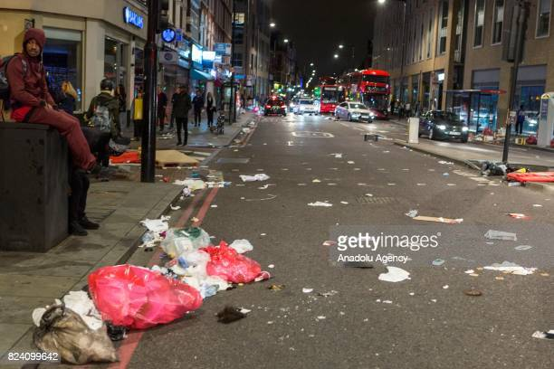 Streets are trashed following a demonstration demanding justice after the death of Rashan Charles who was killed last weekend after police tried to...