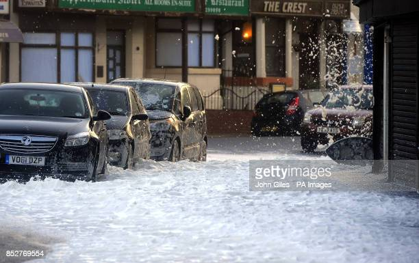Streets in Blackpool fill with white foam driven in from the sea following high tide and a tidal surge with severe gale force winds hitting many...