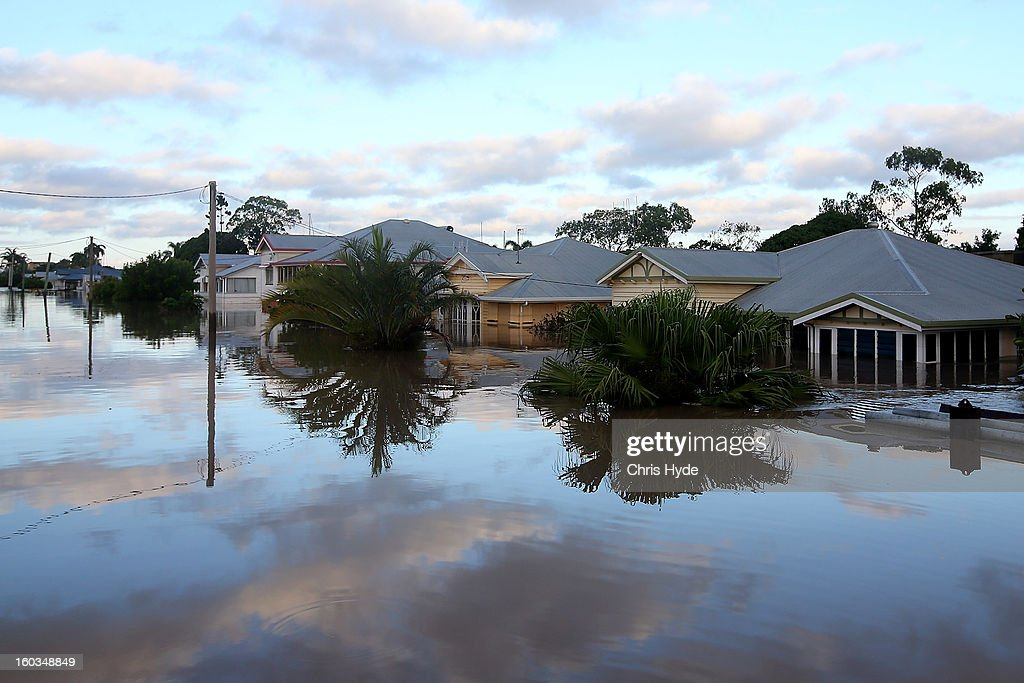 Streets of Bundaberg underwater as parts of southern Queensland experiences record flooding in the wake of Tropical Cyclone Oswald on January 30, 2013 in Bundaberg, Australia. Flood waters peaked at 9.53 metres in Bundaberg yesterday and began receding overnight, as residents and relief teams prepare to clean-up debris. Four deaths have been confirmed in the Queensland floods and the search is on for two men though to be missing in floodaters in Gatton.