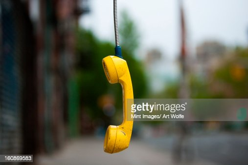 Streets of New York City. USA. An abandoned telephone receiver. : Stock Photo
