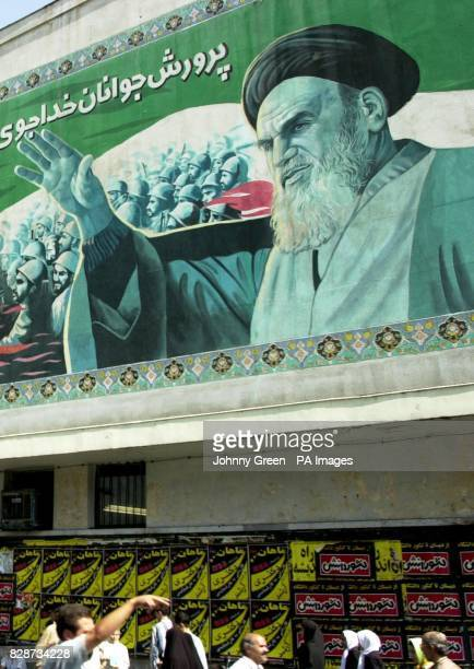 A streetscene in Tehran the capital city of Iran The figure in the tophalf of the picture is Ayatollah Khomeini who ruled Iran between 1979 and 1989...
