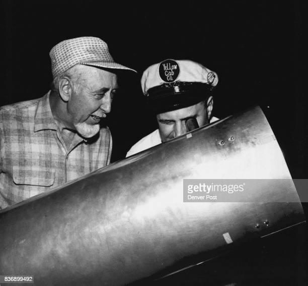 Streetside Vantage Point Winthrop Kimball gives cab driver Donald Orange 431 S Monroe St a peek through his homemade telescope Credit Denver Post