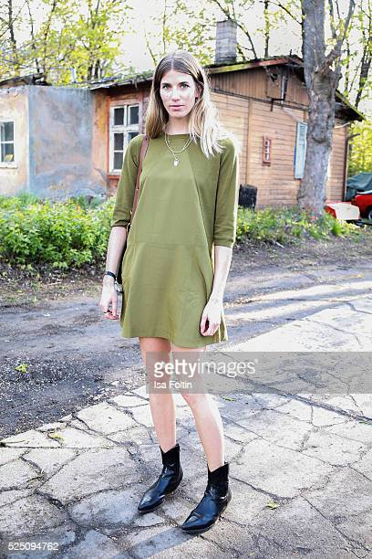 StreetstyleIcon Veronika Heilbrunner wearing a dress of COS attends the presentation of a joint project by COS and Michael Sailstorfer on April 27...